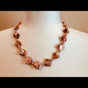 Stunning light coral color and pearl necklace.